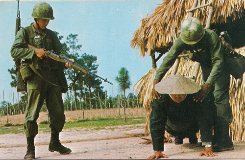 Trainees searching a villager for paperwork and weapons at Tiger Ridge Vietnam Village. (Rickey Robertson Collection)