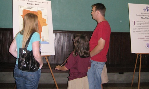 Visitors learn about the Heritage Center